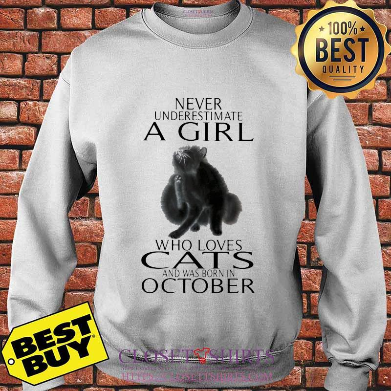 Never underestimate a girl who loves cats and was born in october s Sweater